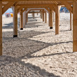 Beach, wooden sun shelters — Stock Photo