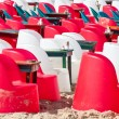 Beach cafe with plastic chairs and tables — Stock Photo