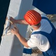 Seaman working on a cruise ship. — Stock Photo