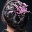 Evening hairstyle with flowers. — Stock Photo