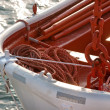 Closeup lifeboat with a rope on the sea. — Stock Photo