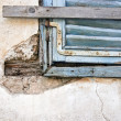 Stockfoto: Old blue window on old wall