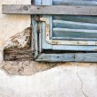 Foto de Stock  : Old blue window on old wall