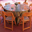 Stok fotoğraf: Table setting for wedding in colored lighting