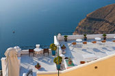 Santorini, a cafe overlooking the sea — Stock Photo