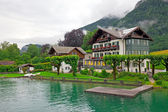 The beautiful house on the lake Wolfgangsee Austria (Village St. — Stock Photo