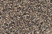 Crushed Black pepper (Piper nigrum) background. — Stock Photo