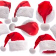 Set red Santa Claus hat on white background — Stock Photo #8036035