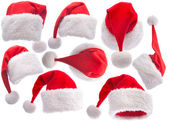 Set red Santa Claus hat on white background — Photo