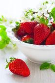 Strawberries in white bowl — Stock Photo