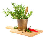 Rosemary in a copper mortar — Stock Photo