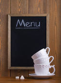 White cups and chalk board — Stock Photo