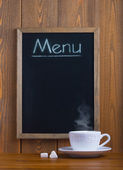 White cup and chalk board — Stock Photo