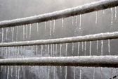 Icicles on railings — Stock Photo