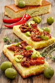 Appetizer of sun-dried tomatoes, olives and thyme. — Stock Photo