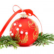 Christmas ball and a pine branch. — Stock Photo #7990236