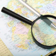 Diary, pen and magnifying glass on a map. Concept of planning va — Stock Photo