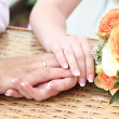 Stock Photo: Hands beside bouquet