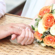 Stock Photo: Hands of bride and groom