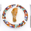 Roasted chicken leg on plate with fork and knife — Stock Photo