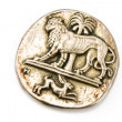 Antique silver brooch with lion and rabbit - Stock Photo