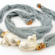 Seashells on colourful female scarf — Stok Fotoğraf #10553765