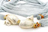 Seashells on colourful female scarf — Foto de Stock