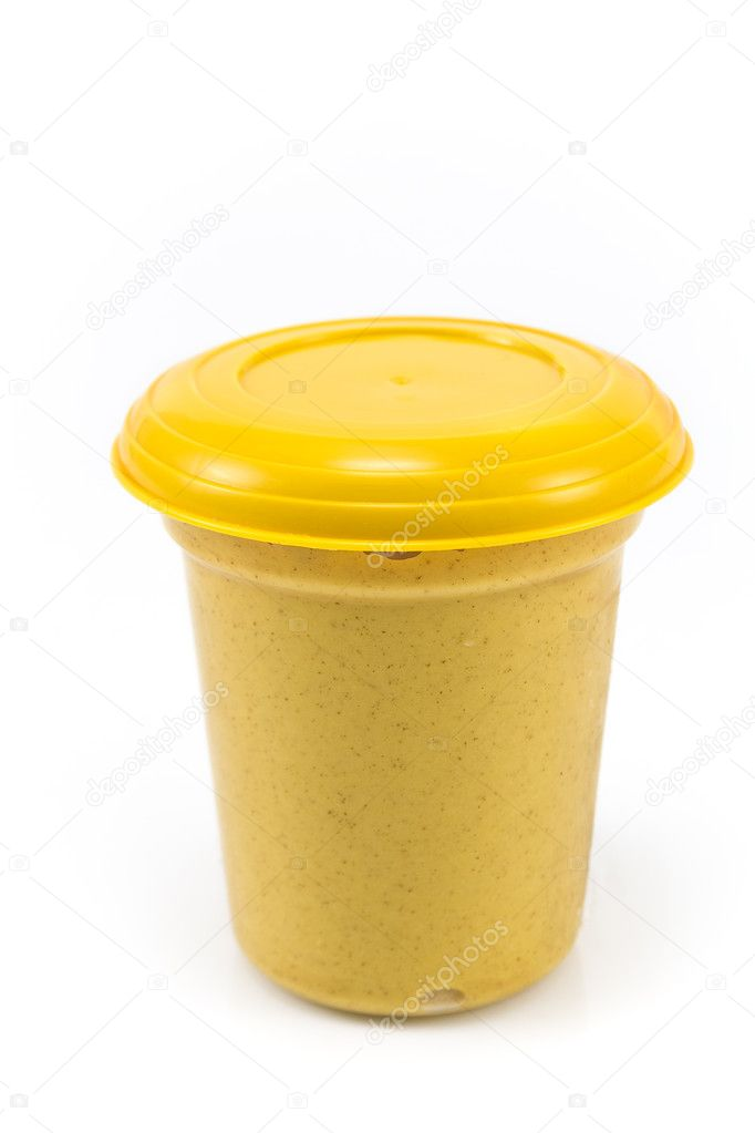 Plastic pot of of mustard isolated on white — Stock Photo #10551881
