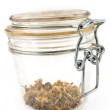 Jar with dried basil — Stock Photo
