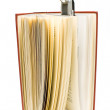 Travel book lamp on red hardcover book — Stock Photo