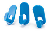 Three blue plastic wall hook hangers — Stock Photo