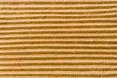 Textuur van bruin plooit karton — Stockfoto