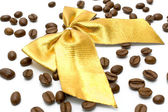 Coffee beans with golden gift bow — Stockfoto
