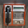 Orange public telephone on metallic background — Foto de stock #9752159
