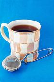Kopje thee en thee-ei — Stockfoto