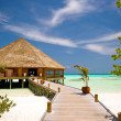 Over water bungalow  into green lagoon — Stock Photo