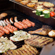 Foto Stock: Meat on BBQ