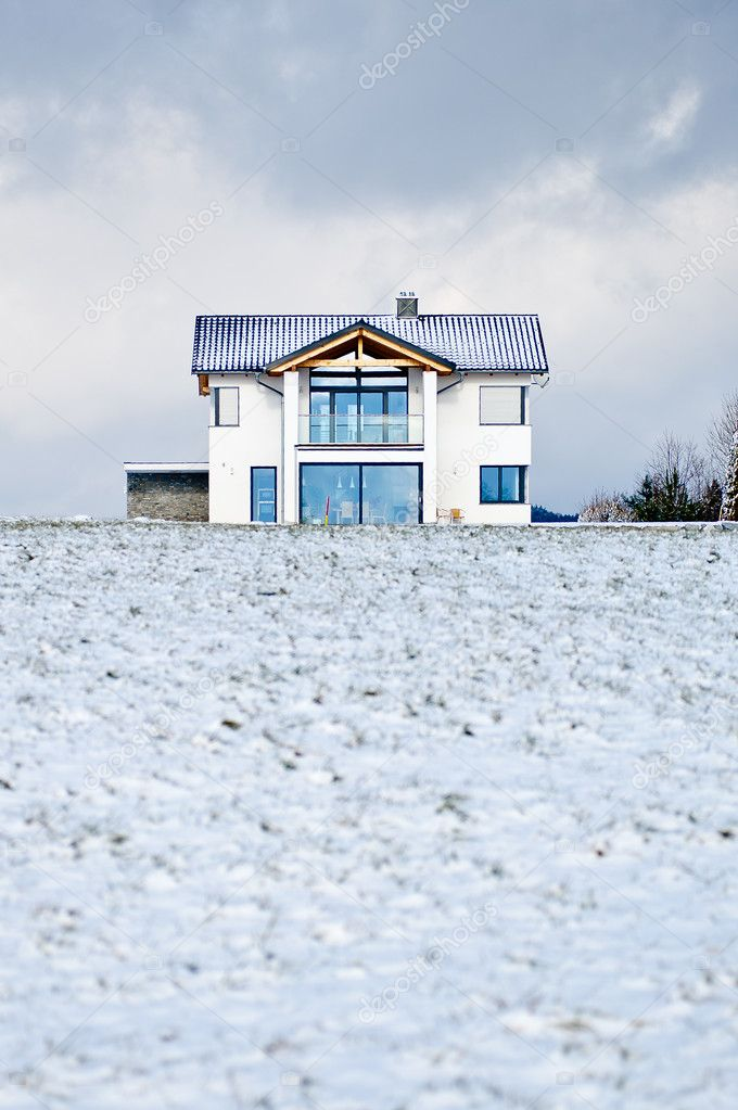 New family house in a winter meadow — Stock Photo #8942256