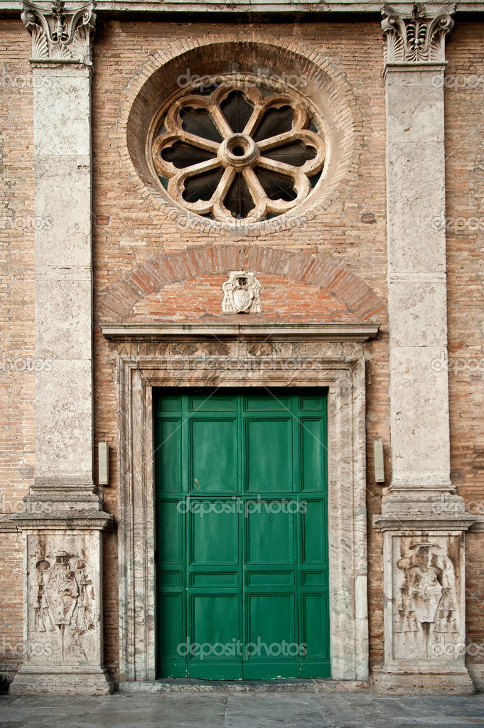 Old roman facade with green door taken in rome  Stock Photo #9305856