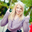 Blonde Woman on a Swing — Stock Photo