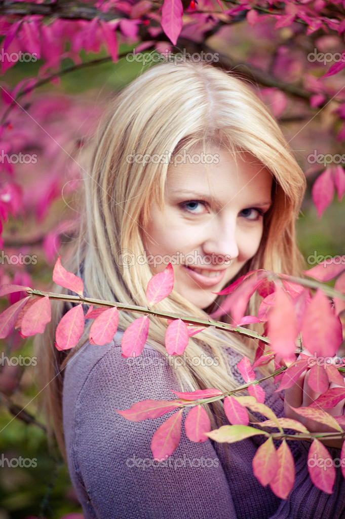 Pink Leaves with a beautiful blonde woman — Stock Photo #9689628