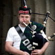 Stock Photo: Bagpiper in Action