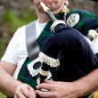 Scotsman playing Bagpipe — Stock Photo
