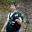 Laughing Bagpiper — Stock Photo