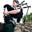 Stock Photo: Bagpiper on Stone Steps