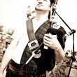 Stock Photo: Portrait of Bagpiper