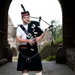 Bagpiper in a mediaval Castle - Stockfoto