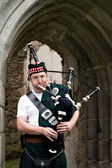 Bagpiper under Archway — Stock Photo