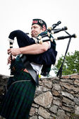 Bagpiper on Stone Steps — Stock Photo
