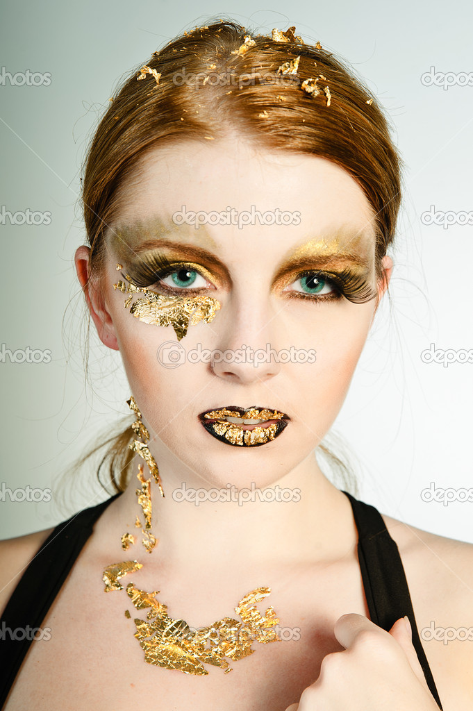 Blonde woman with leaf gold on her face  Stock Photo #9690587